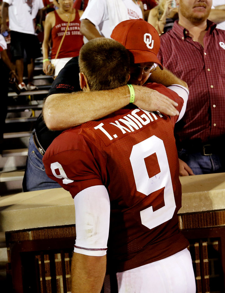 Photo - Oklahoma's Trevor Knight (9) gets hugs from family immediately following the college football game where the University of Oklahoma Sooners (OU) play the University of Louisiana Monroe Warhawks at Gaylord Family-Oklahoma Memorial Stadium in Norman, Okla., on Saturday, Aug. 31, 2013. Photo by Steve Sisney, The Oklahoman