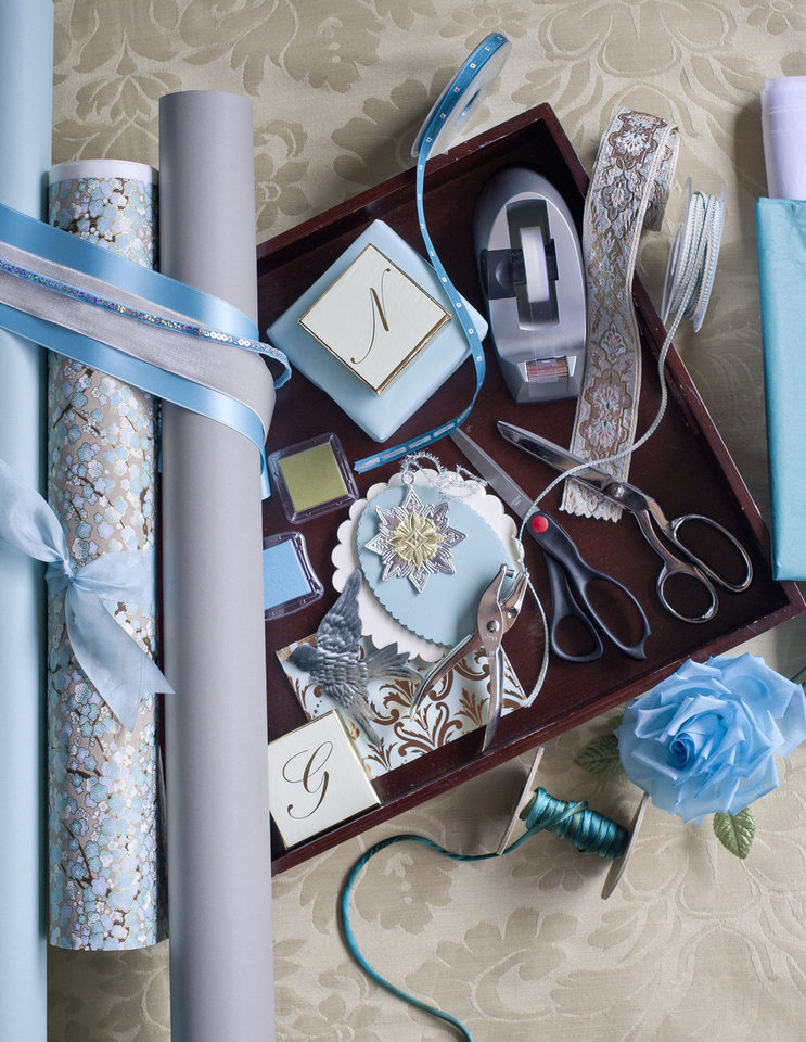 To make your season and your gifts more beautiful, start by getting organized, says gift wrap guru Nickolas Kniel. Your gift wrap station should include paper and ribbon in your signature colors, double-sided tape, and two pairs of scissors.  Photo provided