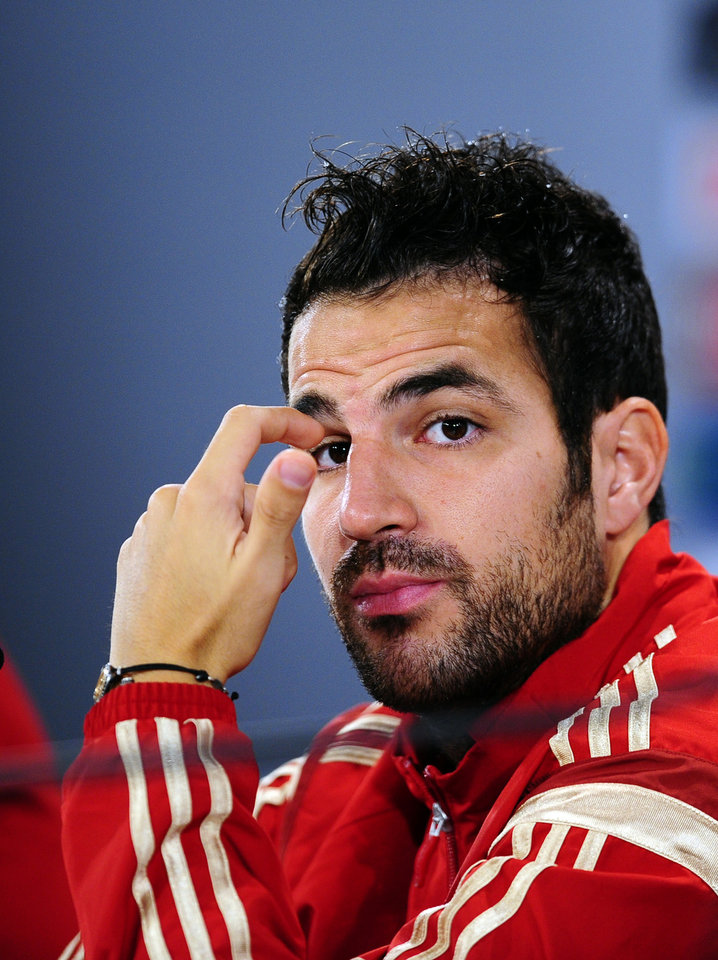 Photo - Spain's Cesc Fabregas gestures during a press conference at the Atletico Paranaense training center in Curitiba, Brazil, Sunday, June 15, 2014. Spain will play in group B of the Brazil 2014 World Cup. (AP Photo/Manu Fernandez)