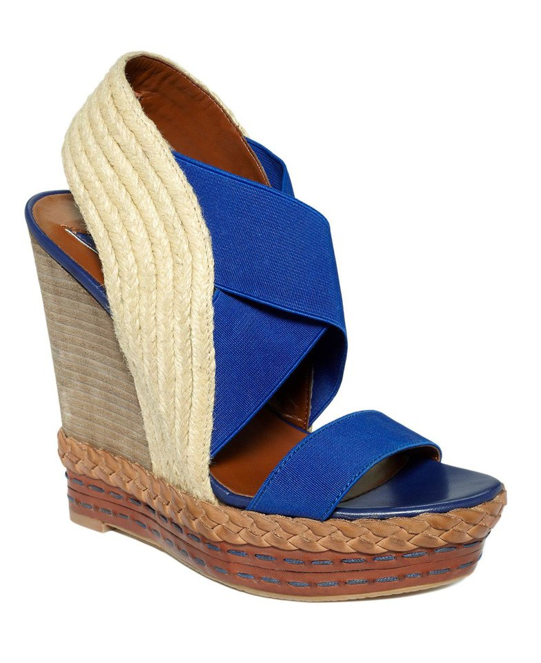 Photo - For a similar look donned by Jessica Alba during a Sunday brunch, try this Boutique 9 Isabella wedge sandal in royal blue, $150 from Macys.com. (Coutesy Macys.com via Los Angeles Times/MCT)