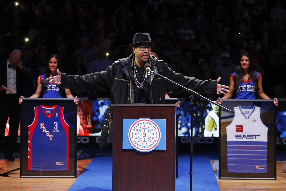 Photo - Former Philadelphia 76er Allen Iverson speaks to the crowd during a retirement ceremony at halftime of an NBA basketball game between the 76ers and the Washington Wizards, Saturday, March 1, 2014, in Philadelphia. (AP Photo/Matt Slocum)