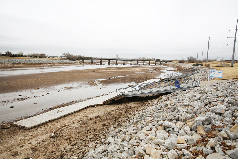 Photo - The Oklahoma River was drained to install a sewer line underneath the area near I-40 in Oklahoma City, Friday December 14, 2012. Photo By Steve Gooch, The Oklahoman