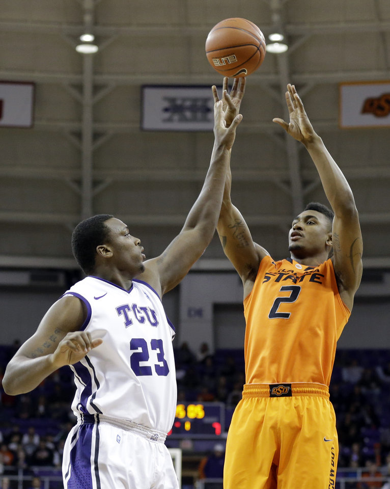 TCU forward Devonta Abron (23) defends as Oklahoma State guard Le'Bryan Nash (2) attempts a shot in the first half of an NCAA basketball game on Wednesday, Feb. 27, 2013, in Fort Worth, Texas. (AP Photo/Tony Gutierrez) ORG XMIT: TXTG101