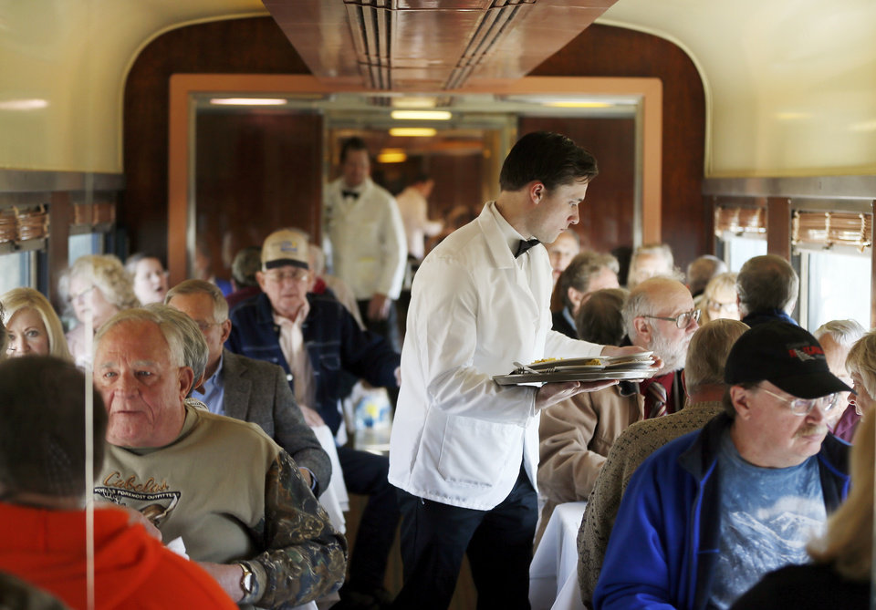 Photo - Passengers eat breakfast in a dining car on a demonstration ride of the Eastern Flyer passenger train from Sapulpa to the Oklahoma City metro area, Sunday, Feb. 23, 2014. Photo by Nate Billings, The Oklahoman