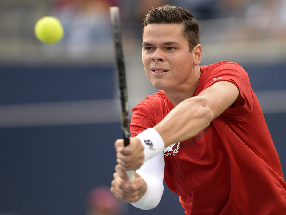 Photo - Milos Raonic, of Canada, returns to Julien Benneteau, of France, during a Rogers Cup tennis match in Toronto on Thursday, Aug. 7, 2014. (AP Photo/The Canadian Press, Frank Gunn)