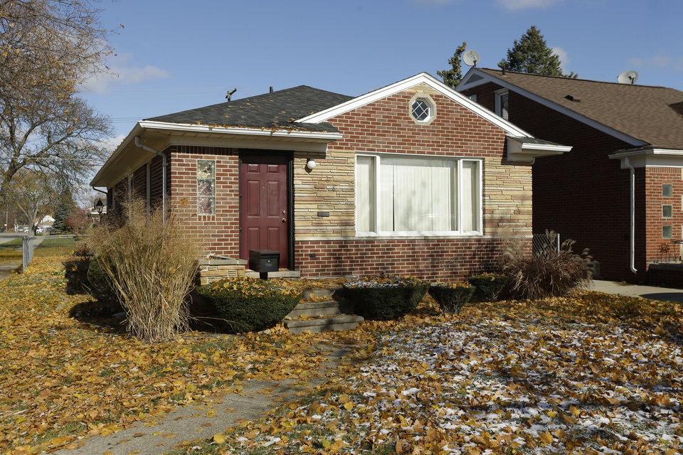 Photo - In this Nov. 12, 2013 photo is the Dearborn Heights, Mich., home where 19-year-old Renisha McBride was shot on Nov. 2  The homeowner, Theodore P. Wafer, 54, was charged Friday, Nov. 15, 2013 with second-degree murder in McBride's death. Police say the former high school cheerleader was shot in the face on Wafer's front porch a couple hours after being involved in a nearby car accident. Family members say she likely approached the home for help. (AP Photo/Carlos Osorio)