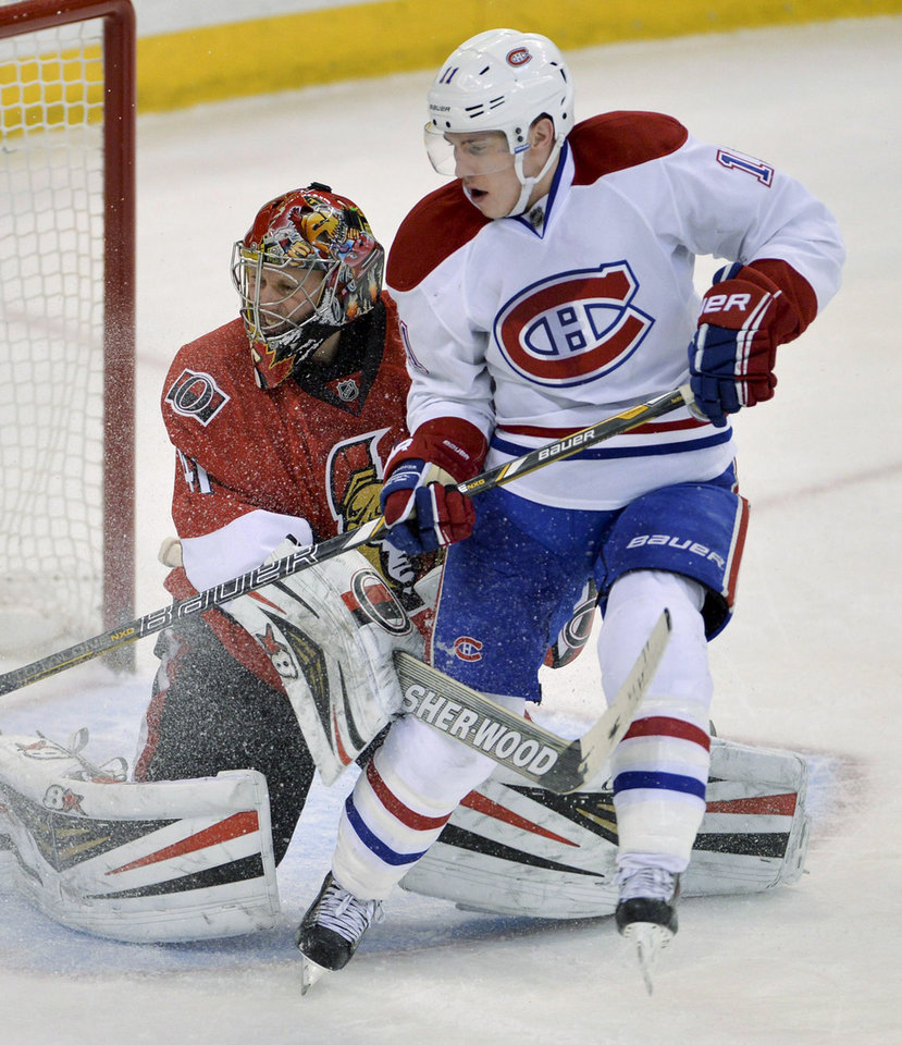 Photo - Montreal Canadiens right wing Brendan Gallagher pressures Ottawa Senators goalie Craig Anderson during the second period of an NHL hockey game Thursday, Jan. 16, 2014, in Ottawa, Ontario. (AP Photo/The Canadian Press, Adrian Wyld)