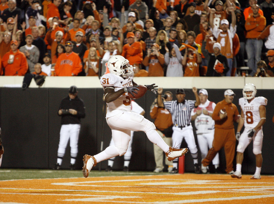 Photo - Texas' Cody Johnson (31) scores a touchdown during the college football game between the Oklahoma State University Cowboys (OSU) and the University of Texas Longhorns (UT) at Boone Pickens Stadium in Stillwater, Okla., Saturday, Oct. 31, 2009. Photo by Sarah Phipps, The Oklahoman