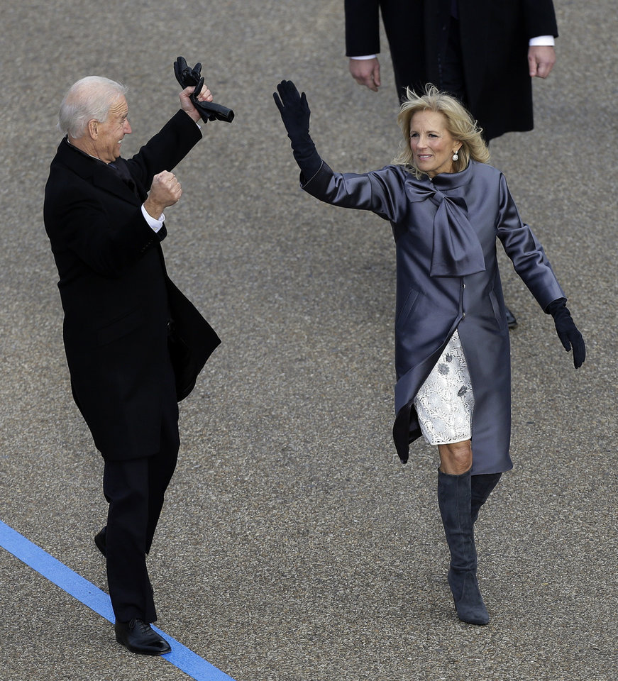 Photo - Vice President Joe Biden and his wife Jill Biden  walk down Pennsylvania Avenue en route to the White House, Monday, Jan. 21, 2013, in Washington. Thousands  marched during the 57th Presidential Inauguration parade after the ceremonial swearing-in of President Barack Obama. (AP Photo/Charlie Neibergall )