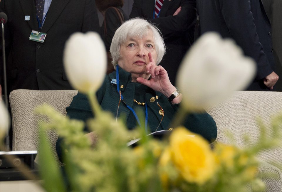 Photo - Federal Reserve Chair Janet Yellen listens during the International Monetary and Financial Committee (IMFC) meeting, Saturday, April 12, 2014, at the World Bank Group-International Monetary Fund Spring Meetings in Washington. ( AP Photo/Jose Luis Magana)