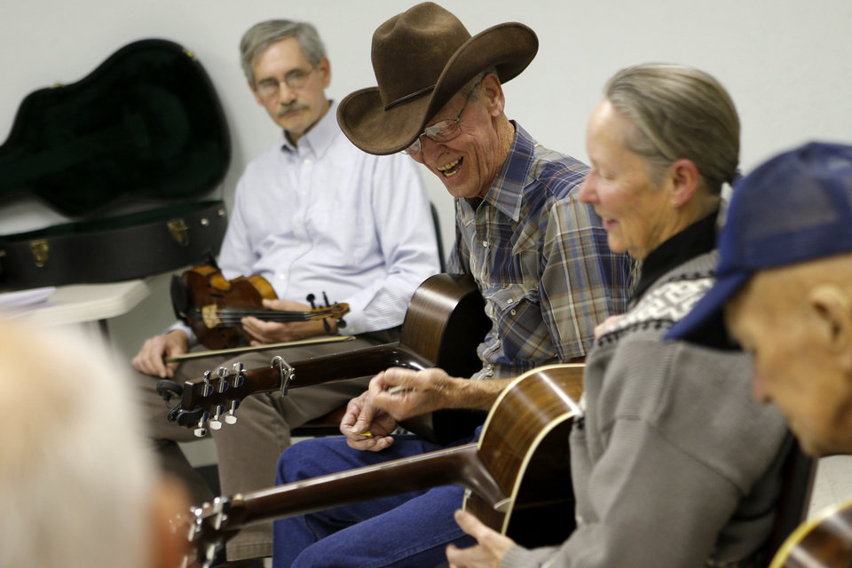 James Staten, of Mustang, laughs during a bluegrass jam session at the Oklahoma Country Western Museum and Hall of Fame in Del City. Photo by Bryan Terry, The Oklahoman <strong>BRYAN TERRY - THE OKLAHOMAN</strong>