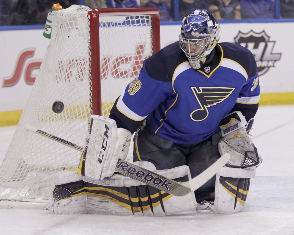 Photo - St. Louis Blues goalie Ryan Miller (39) makes a stick save during the first period of an NHL hockey game against the Washington Capitals, Tuesday, April 8, 2014, in St. Louis.(AP Photo/Tom Gannam)