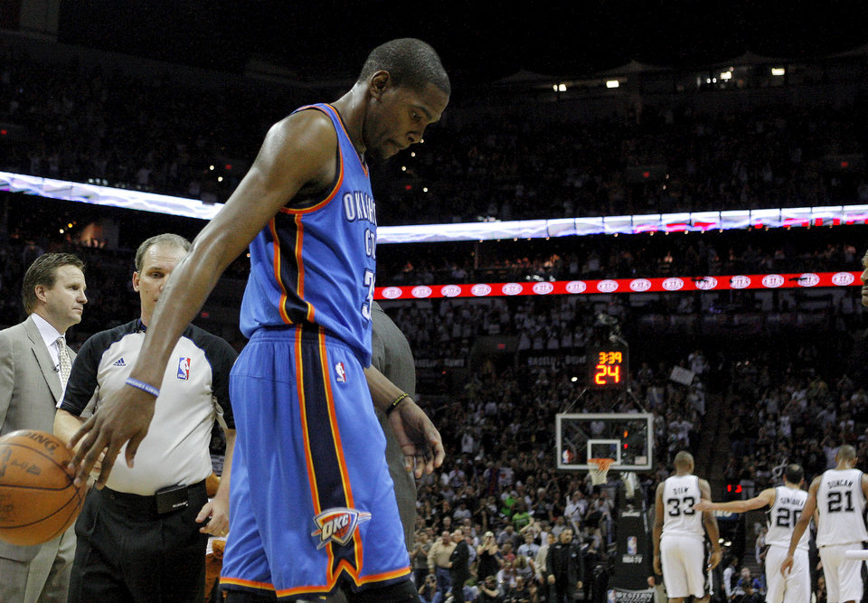 Photo - Oklahoma City's Kevin Durant walks towards the bench during Game 2 of the Western Conference Finals between the Oklahoma City Thunder and the San Antonio Spurs in the NBA playoffs at the AT&T Center in San Antonio, Texas, Tuesday, May 29, 2012. Oklahoma City lost 120-111. Photo by Bryan Terry, The Oklahoman