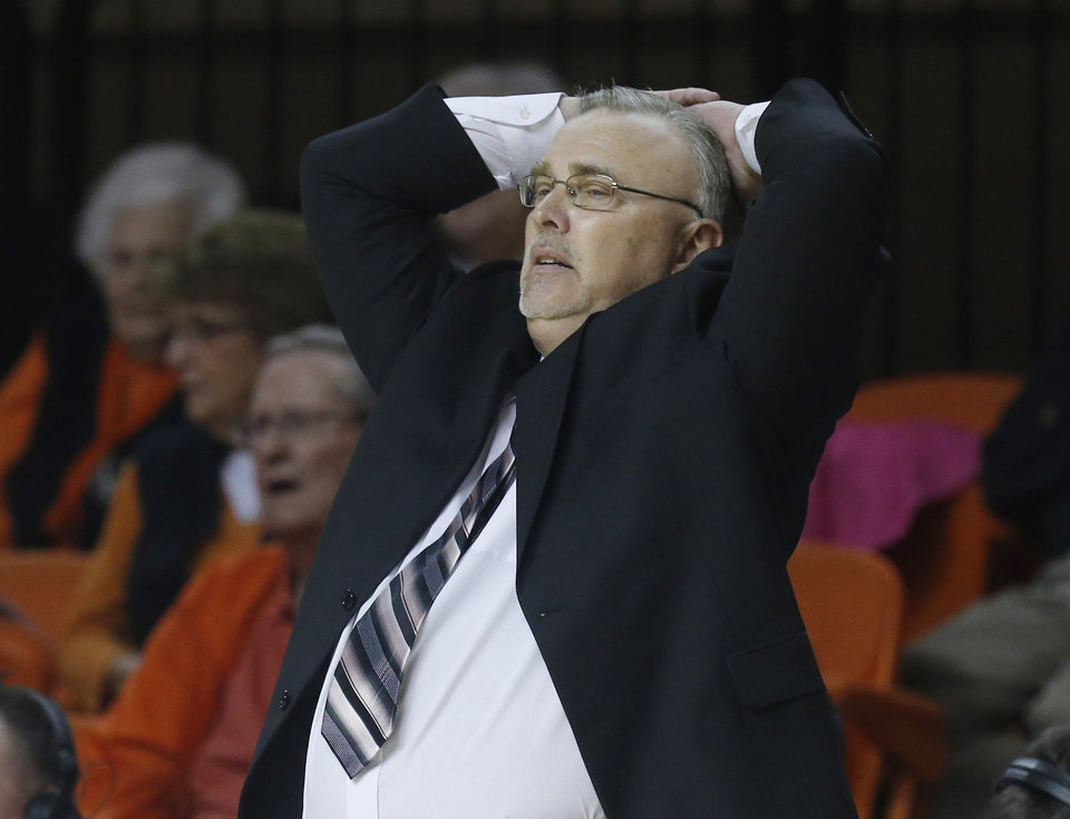 Oklahoma State head coach Jim Littell watches the action in the second half of an NCAA college basketball game against Oklahoma in Stillwater, Okla., Sunday, Feb. 16, 2014. Oklahoma State won 73-57. (AP Photo/Sue Ogrocki)