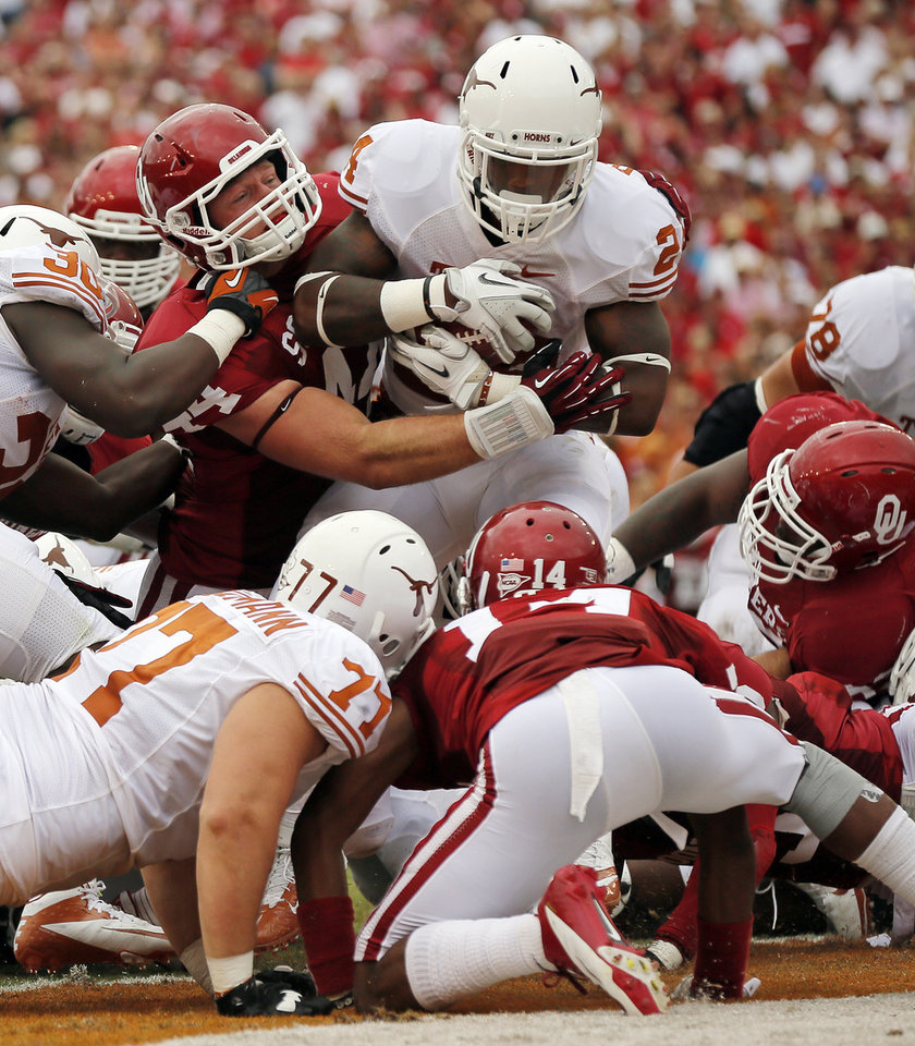 Photo - OU's Jaydan Bird (44) stops UT's Joe Bergeron (24) in the Texas end zone for a safety during the Red River Rivalry college football game between the University of Oklahoma (OU) and the University of Texas (UT) at the Cotton Bowl in Dallas, Saturday, Oct. 13, 2012. OU won, 63-21. Photo by Nate Billings, The Oklahoman