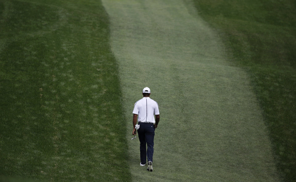 Photo - AP10ThingsToSee - Tiger Woods walks up the 10th fairway after playing practice round on the front nine for the PGA Championship golf tournament at Valhalla Golf Club on Wednesday, Aug. 6, 2014, in Louisville, Ky. (AP Photo/John Locher)