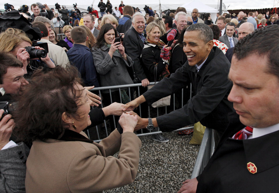 Photo - President Barack Obama shakes hands and talks with people after speaking about energy on March 22, 2012 at the TransCanada Pipe Yard near Cushing. [Photo by Nate Billings, The Oklahoman]