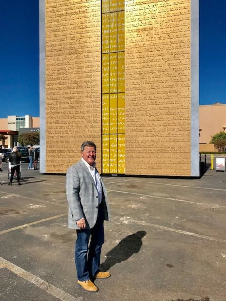 Photo - Steven Bickley, vice president of marketing for the Museum of the Bible, stands in front of the Gutenberg Gates replica erected at Penn Square Mall to raise awareness about the new museum opening soon in Washington, D.C. [Photo by Carla Hinton, The Oklahoman]