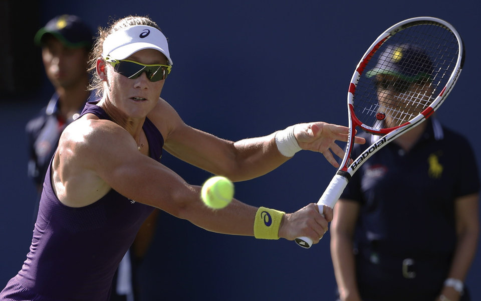 Photo - Samantha Stosur, of Australia, returns a shot against Kaia Kanepi, of Estonia, during the second round of the 2014 U.S. Open tennis tournament, Thursday, Aug. 28, 2014, in New York. (AP Photo/Kathy Willens)