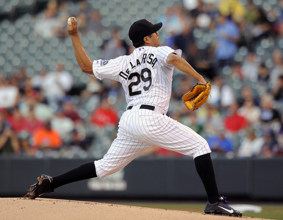 Photo - Colorado Rockies starting pitcher Jorge De La Rosa throws in the first inning of a baseball game against the Cincinnati Reds on Thursday, Aug. 14, 2014, in Denver. (AP Photo/Chris Schneider)