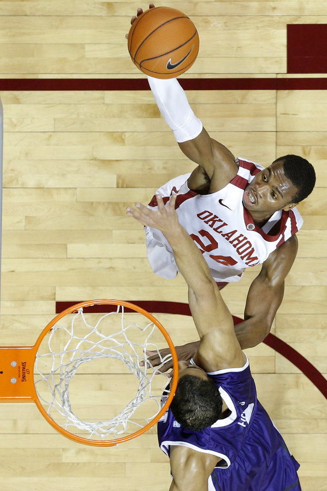 Oklahoma's Buddy Hield (24) goes to the basket past TCU's Amric Fields (4) during an NCAA college basketball game between the University of Oklahoma (OU) and Texas Christian University (TCU) at Lloyd Noble Center, Wednesday, Jan. 22, 2014.  Photo by Bryan Terry, The Oklahoman