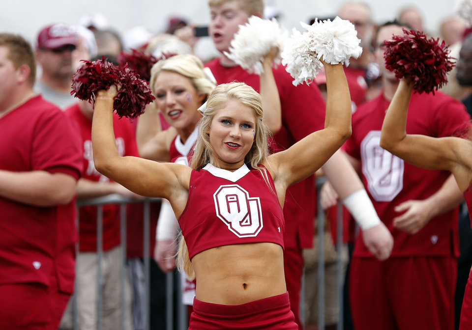 Photo - Members of the Oklahoma cheer squad greet the football team as they arrive to the stadium during the Red River Rivalry college football game between the University of Oklahoma Sooners (OU) and the University of Texas Longhorns (UT) at the Cotton Bowl Stadium in Dallas, Saturday, Oct. 12, 2013. Photo by Chris Landsberger, The Oklahoman