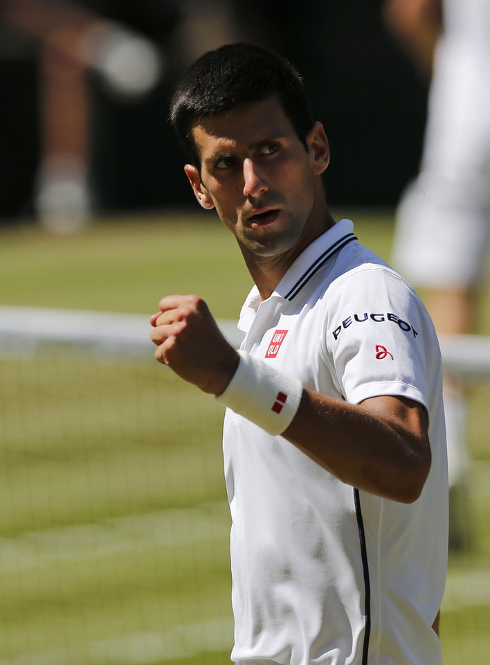 Photo - Novak Djokovic of Serbia celebrates a point  during the men's singles semifinal match against Grigor Dimitrov of Bulgaria at the All England Lawn Tennis Championships in Wimbledon, London, Friday, July 4, 2014. (AP Photo/Ben Curtis)