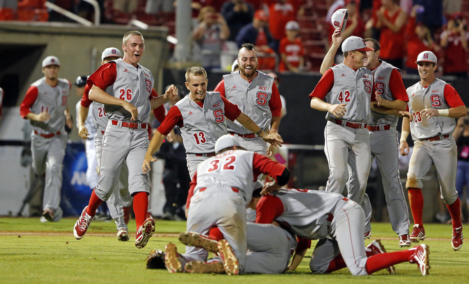 North Carolina State players come to join Tarran Senay, Trea Turner, and Ethan Ogburn, in the infield following State's 5-4 win over Rice in 17 innings of an NCAA college baseball tournament super regional game, Sunday, June 9, 2013, in Raleigh, N.C. (AP Photo/Karl B DeBlaker)