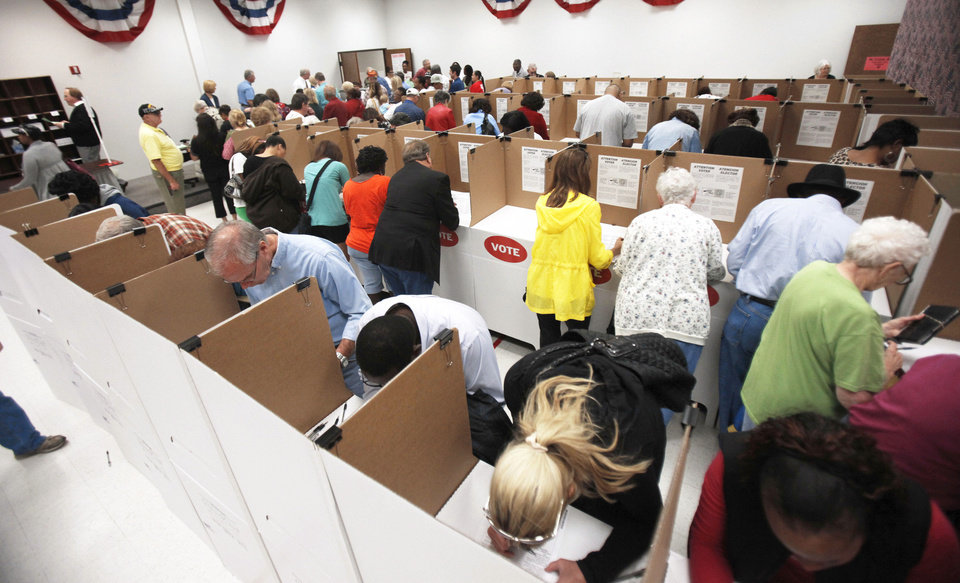 Voters turn out in large numbers Friday as early voting begins at the Oklahoma County Election Board. Photo By Paul Hellstern, The Oklahoman