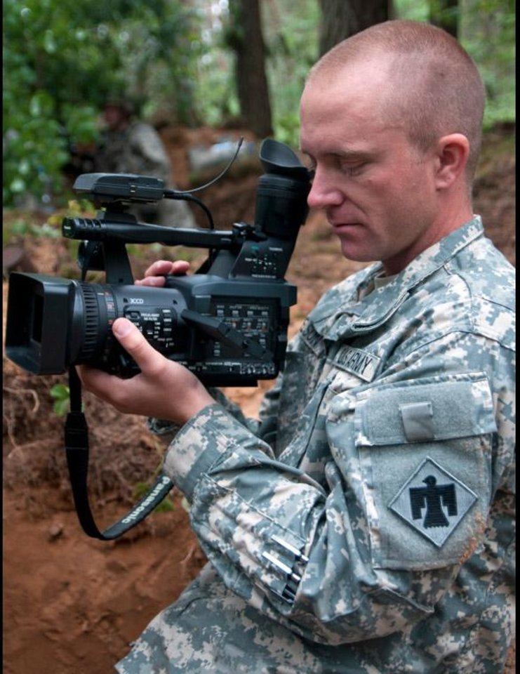 Photo -  Sgt. Daniel Nelson, of Yukon, makes a video of soldiers in Rukla, Lithuania, during a NATO training exercise on June 14. Nelson belongs to the 145th Mobile Public Affairs Detachment, which was sent to four countries to tell the story of the 173rd Airborne Brigade and their training in the Baltic region. PHOTO BY SGT. DANIEL NELSON, OKLAHOMA ARMY NATIONAL GUARD   Sgt. Daniel Nelson -  Sgt. Daniel Nelson, 145 MPAD, Oklahoma Army National Guard