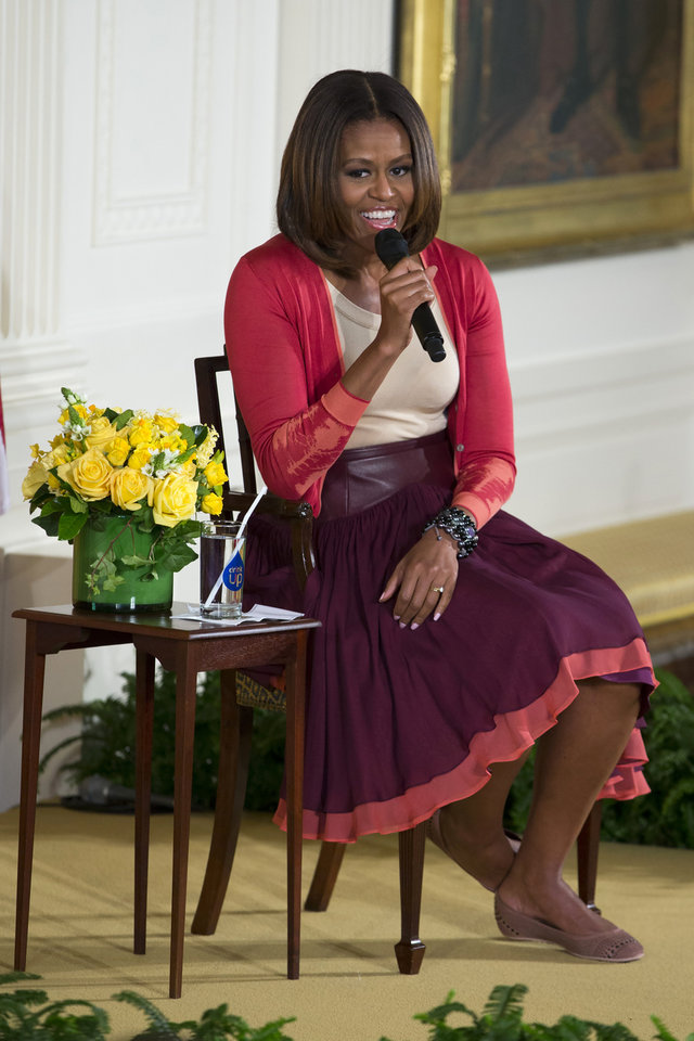 Photo - First lady Michelle Obama smiles as she answers questions during the White House's annual
