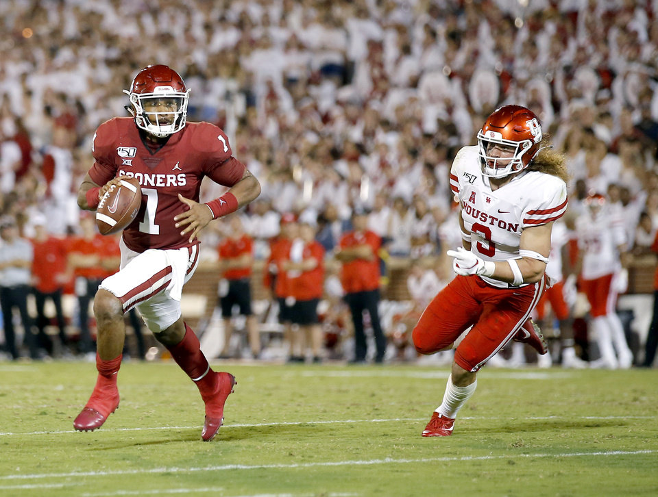 Photo - Oklahoma's Jalen Hurts (1) rushes for a touchdown as he is chased by Houston's Grant Stuard (3) in the third quarter during a college football game between the University of Oklahoma Sooners (OU) and the Houston Cougars at Gaylord Family-Oklahoma Memorial Stadium in Norman, Okla., Sunday, Sept. 1, 2019. [Sarah Phipps/The Oklahoman]
