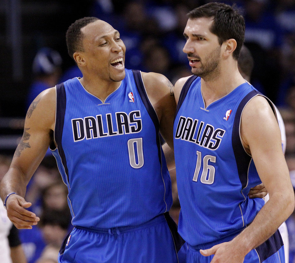 Shawn Marion (0) of Dallas and Peja Stojakovic (16) of Dallas react after taking a lead over the Thunder in the first half during game 3 of the Western Conference Finals of the NBA basketball playoffs between the Dallas Mavericks and the Oklahoma City Thunder at the OKC Arena in downtown Oklahoma City, Saturday, May 21, 2011. Photo by Chris Landsberger, The Oklahoman