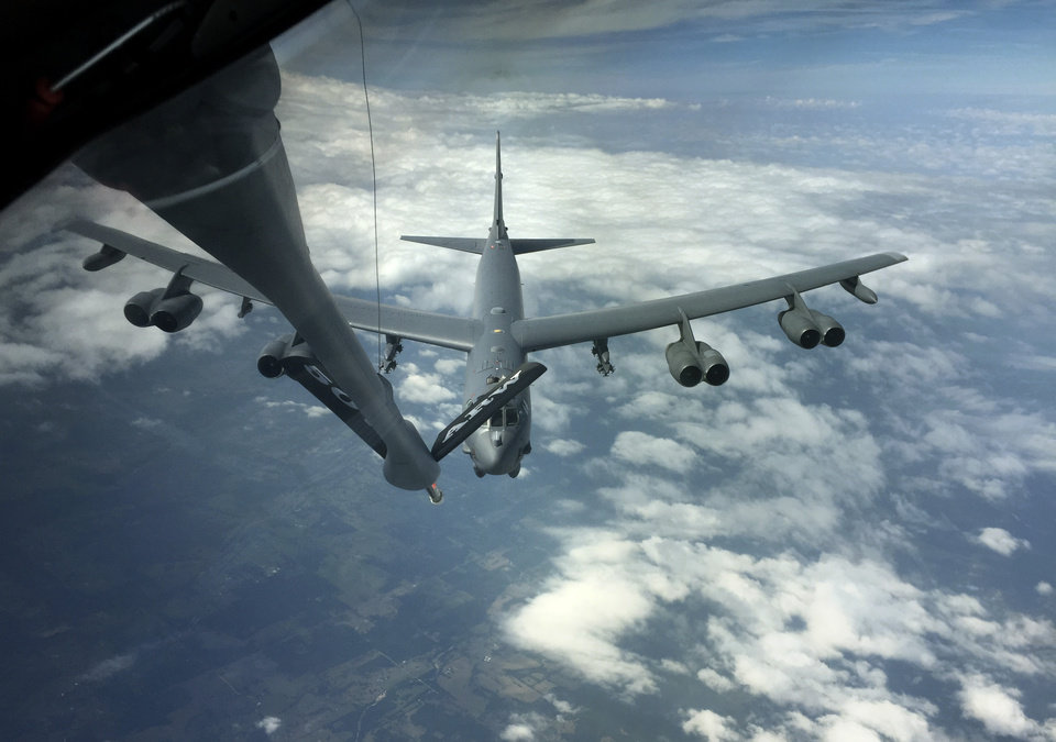 Photo -  A B-52 Stratofortress maneuvers into position during a practice rendezvous with an KC-135 Stratotanker. The tanker's crew are members of the 507th Air Refueling Wing, a U.S. Air Force Reserve unit based at Tinker Air Force Base. [Photo by Paul Hellstern, The Oklahoman]