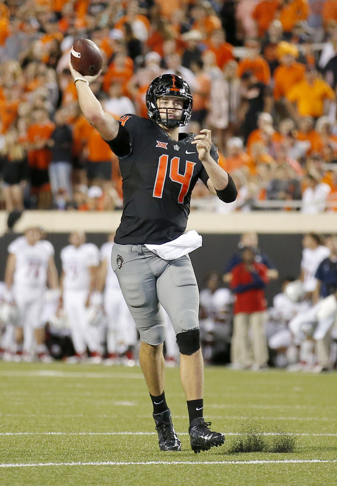 Photo - Oklahoma State's Taylor Cornelius (14) throws an interception in the third quarter during a college football game between Oklahoma State (OSU) and South Alabama at Boone Pickens Stadium in Stillwater, Okla., Saturday, Sept. 8, 2018. Photo by Sarah Phipps, The Oklahoman