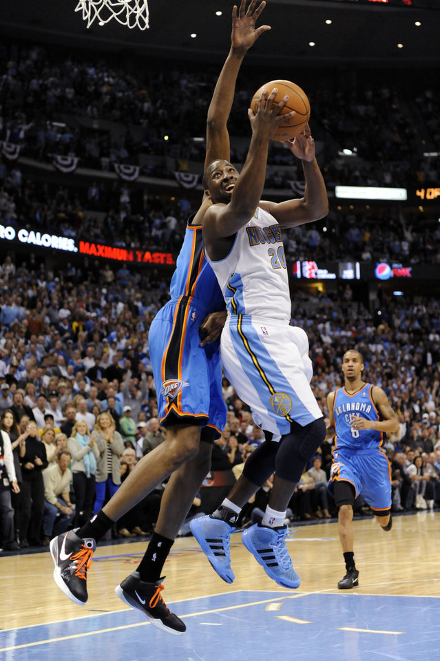 Photo - Denver Nuggets guard Raymond Felton (20) goes up for a shot during the second half of game 3 of a first-round NBA basketball playoff series against the Oklahoma City Thunder Saturday, April 23, 2011, in Denver. (AP Photo/Jack Dempsey)