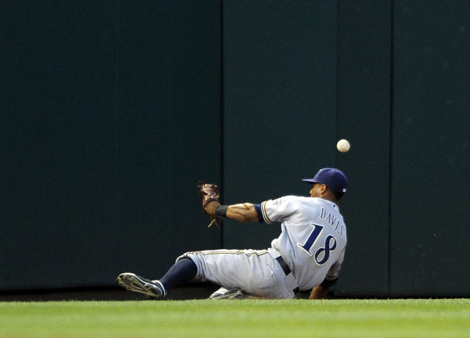 Photo - Milwaukee Brewers left fielder Khris Davis can't get to a double by Washington Nationals' Bryce Harper during the third inning of a baseball game, Saturday, July 19, 2014, in Washington. (AP Photo/Nick Wass)