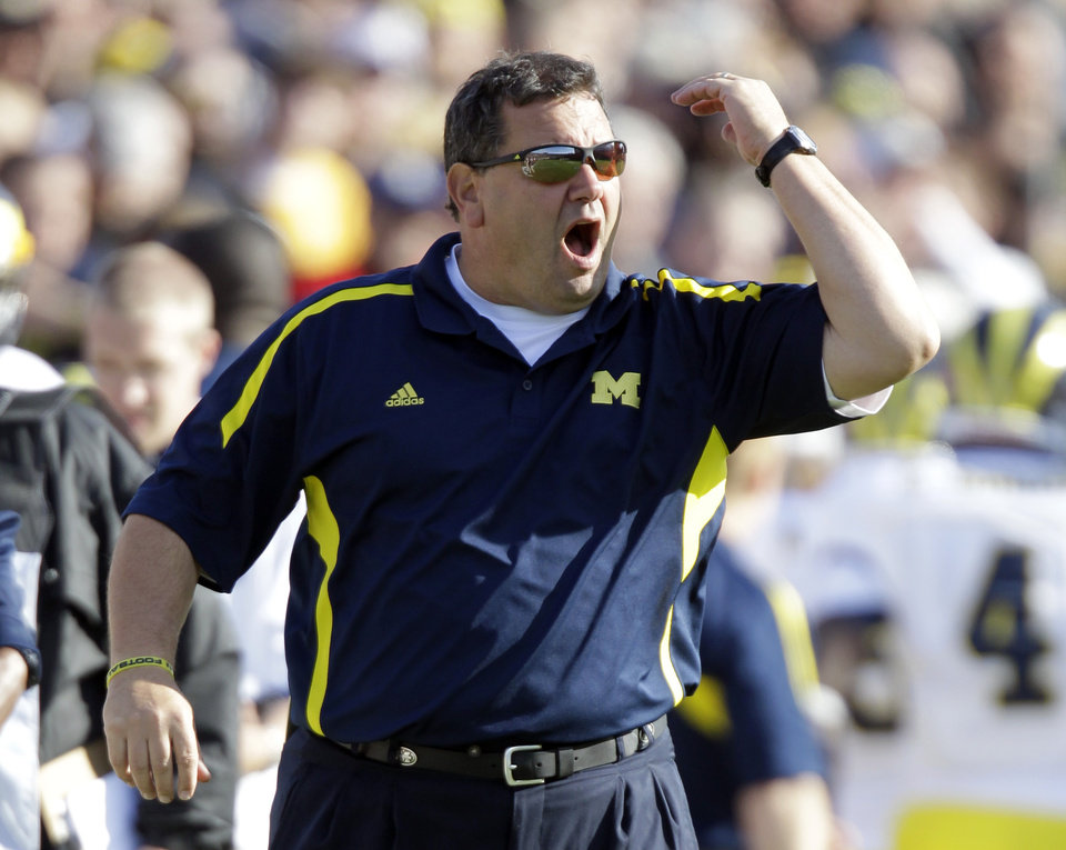 Michigan head coach Brady Hoke yells to his team as they play against Purdue during the first half of an NCAA college football game in West Lafayette, Ind., Saturday, Oct. 6, 2012. (AP Photo/Michael Conroy)