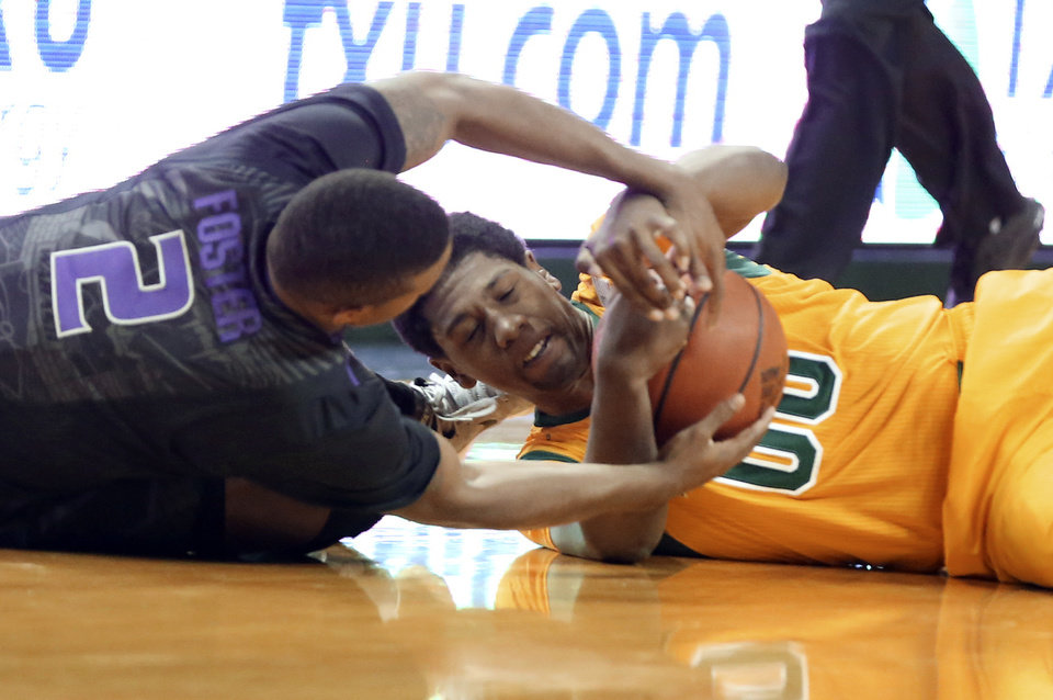 Photo - Baylor's Royce O'Neale, right, battles Kansas State guard Marcus Foster (2) for the ball in the first half of an NCAA college basketball game Saturday, Feb. 15, 2014, in Waco, Texas. (AP Photo/The Waco Tribune-Herald, Rod Aydelotte)