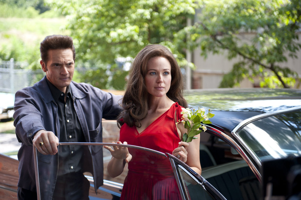 "This publicity image released by A&E Television Networks shows Matt Ross as Johnny Cash, left, and Jewel as June Carter Cash in a scene from the  Lifetime Original Movie, ""Ring of Fire,"" premiering Monday, May 27 at 9pm ET/PT on Lifetime. (AP Photo/A&E Television Networks, Annette Brown)"