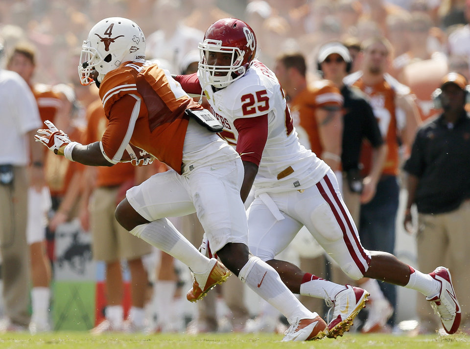 Photo - UT's Daje Johnson (4) returns a punt for a touchdown past OU's Aaron Franklin (25) in the third quarter during the Red River Rivalry college football game between the University of Oklahoma Sooners and the University of Texas Longhorns at the Cotton Bowl Stadium in Dallas, Saturday, Oct. 12, 2013. UT won, 36-20. Photo by Nate Billings, The Oklahoman