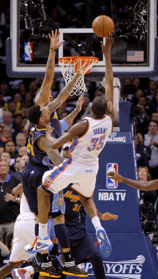 Oklahoma City's Kevin Durant (35) makes a basket as he is fouled by Denver's Wilson Chandler (21) in the dinal minute of the NBA basketball game between the Denver Nuggets and the Oklahoma City Thunder in the first round of the NBA playoffs at the Oklahoma City Arena, Wednesday, April 27, 2011. Photo by Bryan Terry, The Oklahoman