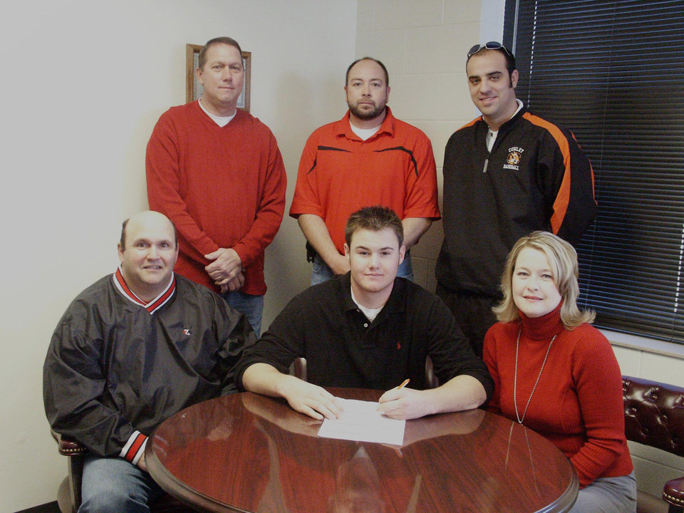 Zach Cargill, Washington High School, signed to play baseball with Crowley College in Arkansas City, Kansas.  Pictured (seated l-r), father,David Cargill, Zach Cargill, mother, Jana Cargill.  (Standing l-r), CC Asst Coach, Darren Burroughs, WHS Baseball Coach David Vallerand, CC Asst. Coach J.R. Demicurio.<br/><b>Community Photo By:</b> LuGlena Moore<br/><b>Submitted By:</b> LuGlena, Washington