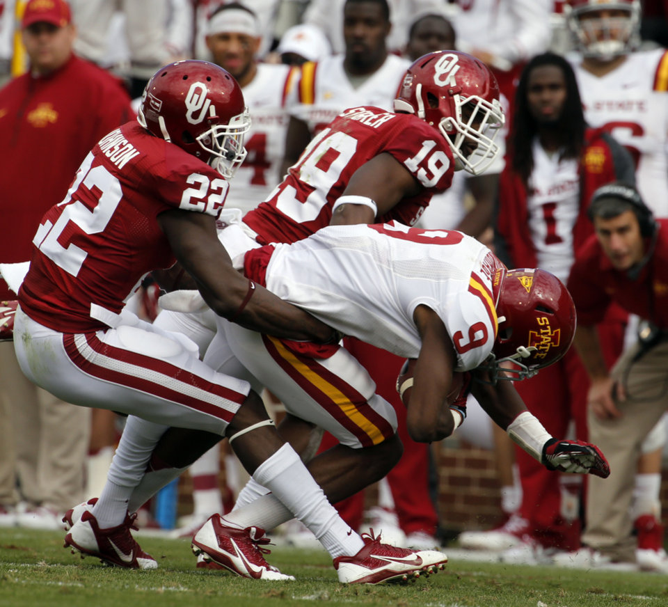 Oklahoma Sooner\'s Cortez Johnson (22) and Eric Striker stop Iowa State Cyclone\'s Quenton Bundrage during the college football game between the University of Oklahoma Sooners (OU) and the Iowa State University Cyclones (ISU) at Gaylord Family-Oklahoma Memorial Stadium in Norman, Okla. on Saturday, Nov. 16, 2013. Photo by Steve Sisney, The Oklahoman