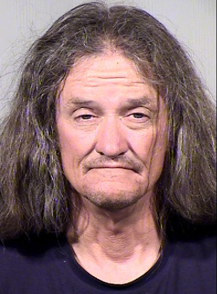 Photo - Gary Moran is seen in this June 16, 2014 booking photo provided by the Maricopa County Sheriffs Office. Moran is being held on suspicion of first-degree murder, burglary and armed robbery, among others charges in the killing of a Roman Catholic priest and the beating of a second priest at a downtown Phoenix church. The Rev. Kenneth Walker was shot and killed and the Rev. Joseph Terra was badly beaten and remains hospitalized from the Wednesday, June 11, 2014 attack at the Mother of Mercy Mission Catholic church in Phoenix.  (AP Photo/Maricopa Country Sheriffs Office)