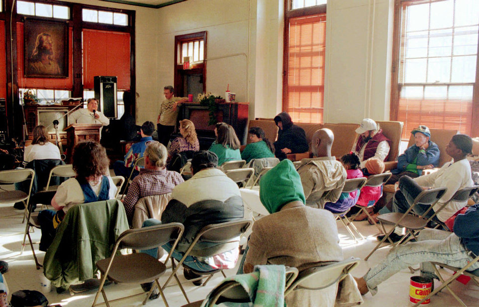 Photo - In this 1996 photo, people are shown attending Sunday church services at the Jesus House, which provided a place for many to escape the sub-freezing temperatures.  JIM BECKEL