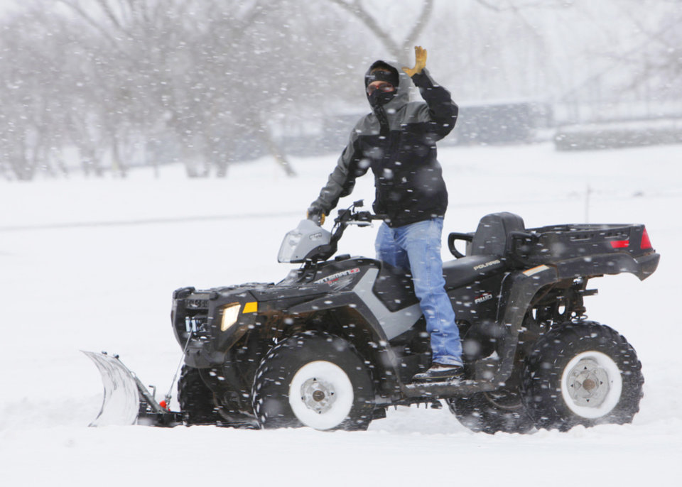 Photo - Jerrod Dean, a 33-year-old Oklahoma Christian University maintenance worker, used a four-wheeler with a blade attached to help clear campus sidewalks Wednesday morning, Wednesday, February 9 , 2011. Photo by David McDaniel, The Oklahoman