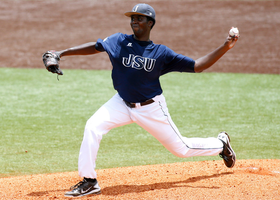 Photo - Jackson State pitcher Chris Wingard works in the first inning during an NCAA college baseball tournament regional game against Louisiana-Lafayette, Sunday, June 1, 2014, in Lafayette, La. (AP Photo/Jonathan Bachman)