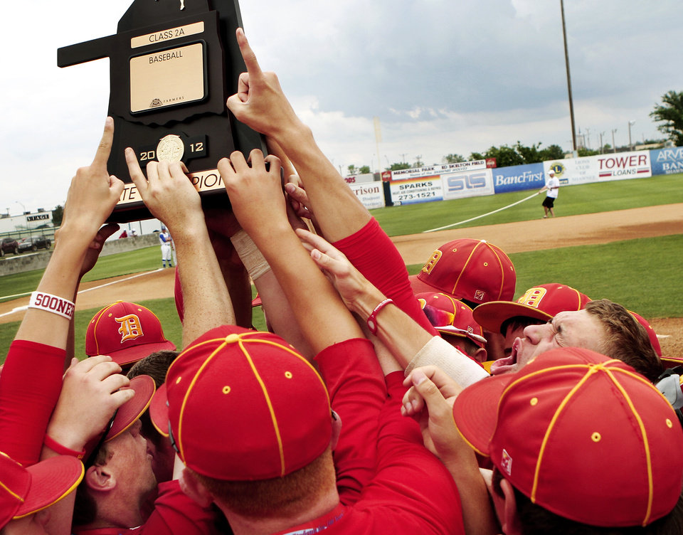 Dale players celebrate winning the state championship trophy after the Class 2A state high school baseball championship game at Shawnee High School\'s Memorial Park. on Saturday,, May 12, 2012. Dale shut-out the Silo Rebels, 11-0 after 6 innings. Photo by Jim Beckel, The Oklahoman