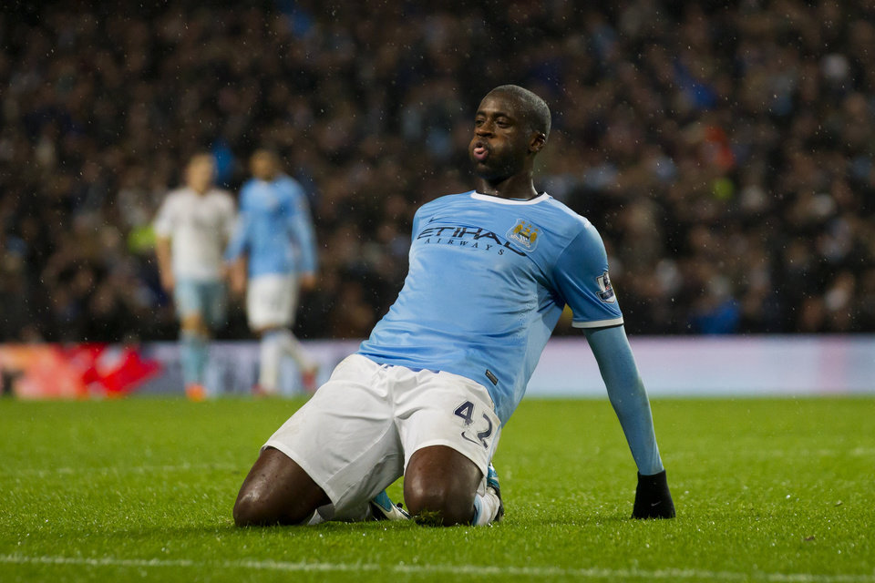 Photo - Manchester City's Yaya Toure celebrates after scoring against West Ham during their English League Cup semi-final soccer match at the Etihad Stadium, Manchester, England, Wednesday Jan. 8, 2014. (AP Photo/Jon Super)